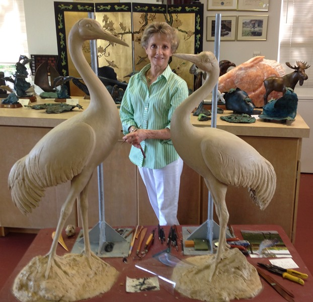 Cathy Standing with bird sculpture